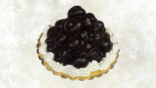 PROFITEROLES - Bignoline farcite con crema pasticcera ricoperte con una ganache al cioccolato, decorata con panna